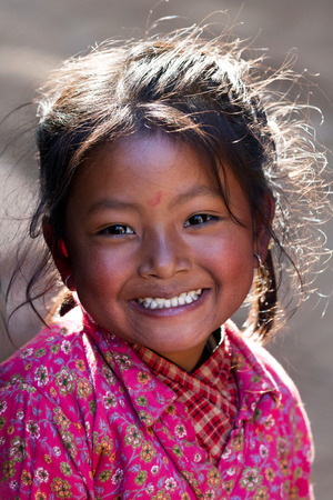BHAKTAPUR, NEPAL - JANUARY 08: Nevaris schoolgirl Lakshmi, 8, poses for a photo during her breaktime on January 08, 2010 in Bhaktapur, Kathmandu Valley, Nepal.