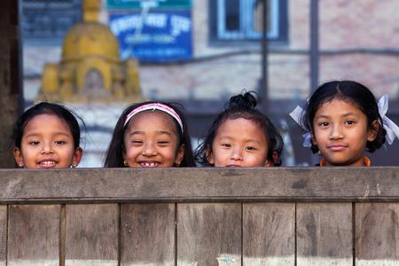 BHAKTAPUR, NEPAL - JANUARY 8: Nepalese schoolgirls poses for a photo during their break time on January 8, 2010 in Bhaktapur, Kathmandu Valley, Nepal