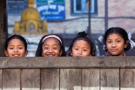 BHAKTAPUR, NEPAL - JANUARY 8: Nepalese schoolgirls poses for a photo during their break time on January 8, 2010 in Bhaktapur, Kathmandu Valley, Nepal