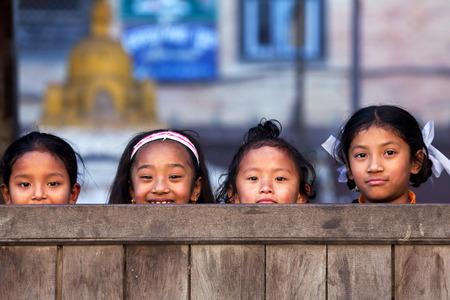 BHAKTAPUR, NEPAL - JANUARY 8: Nepalese schoolgirls poses for a photo during their break time on January 8, 2010 in Bhaktapur, Kathmandu Valley, Nepal.