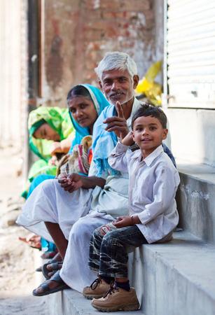 doorstep: Smiling Nepalese people resting resting on the doorstep of their home in Kathmandu, Nepal