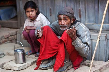 penury: KKATHMANDU, NEPAL - JANUARY 08, 2010: Nepalese people seeking alms on the street. Editorial