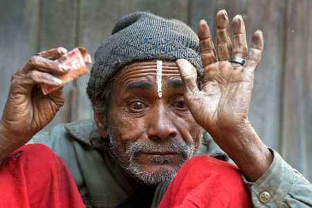 pauper: KATHMANDU, NEPAL - JANUARY 08, 2010: Nepalese man seeking alms on the street.