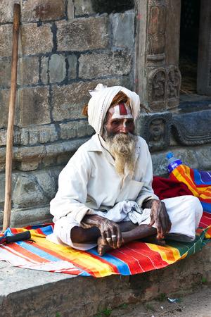 seeks: KATHMANDU, NEPAL - NOVEMBER 13: Sadhu seeks alms in Pashupatinath temple on November 13, 2009 in Kathmandu, Nepal Editorial