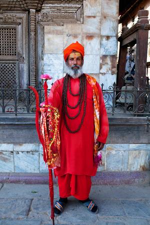 seeks: KATHMANDU, NEPAL - JANUARY 8: Shaiva sadhu seeks alms on the street on January 8, 2010 in Kathmandu, Nepal. Editorial
