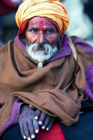 seeks: KATHMANDU, NEPAL - JANUARY 8: Indian fortune teller seeks alms on the street on January 8, 2010 in Kathmandu, Nepal. Editorial