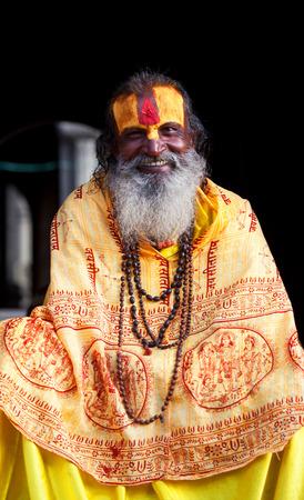 seeks: KATHMANDU, NEPAL - NOVEMBER 13: Shaiva sadhu seeks alms on the street on November 13, 2009 in Kathmandu, Nepal.
