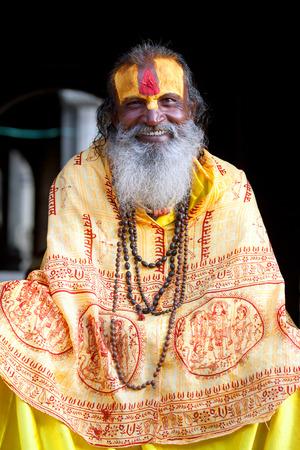 sadhu: KATHMANDU, NEPAL - NOVEMBER 13: Shaiva sadhu seeks alms on the street on November 13, 2009 in Kathmandu, Nepal.