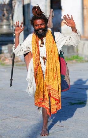 seeks: KATHMANDU, NEPAL - NOVEMBER 13:Sadhu seeks alms in Pashupatinath temple on November 13, 2009 in Kathmandu, Nepal. Editorial