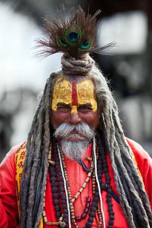 KATHMANDU, NEPAL - NOVEMBER 14: Shaiva sadhu seeks alms at Durbar Square on November 14, 2009 in Kathmandu, Nepal.