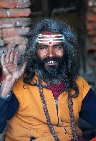 sadhu: KATHMANDU, NEPAL - JANUARY 9: Shaiva sadhu seeks alms on the street on January 9, 2010 in Kathmandu, Nepal Editorial