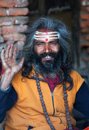 seeks: KATHMANDU, NEPAL - JANUARY 9: Shaiva sadhu seeks alms on the street on January 9, 2010 in Kathmandu, Nepal Editorial