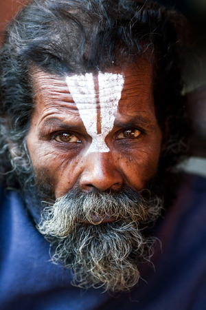 sadhu: KATHMANDU, NEPAL - JANUARY 9: Shaiva sadhu seeks alms on the street on January 9, 2010 in Kathmandu, Nepal. Editorial