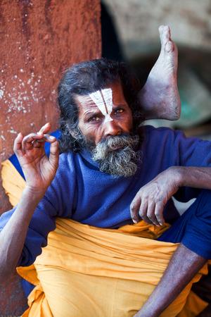 seeks: KATHMANDU, NEPAL - JANUARY 9: Shaiva sadhu seeks alms on the street on January 9, 2010 in Kathmandu, Nepal. Editorial