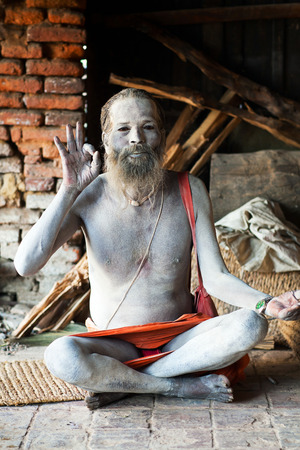 sadhu: KATHMANDU, NEPAL - JUNE 5: Sadhu seeking alms in Pashupatinath Temple on June 5, 2012 in Kathmandu, Nepal.