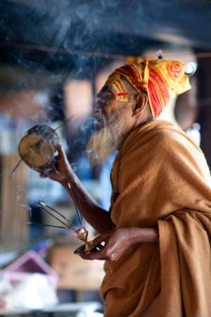 sadhu: KATHMANDU, NEPAL - JUNE 5: Sadhu conducts Puja ceremony in Pashupatinath Temple on June 5, 2012 in Kathmandu, Nepal.