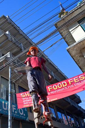 penury: KATHMANDU, NEPAL - JANUARY 10: Nepalese acrobat seeking alms on the street on January 10, 2010 in Kathmandu, Nepal