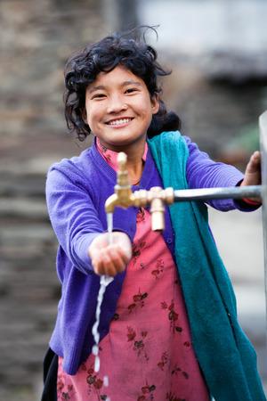 GORKHA, NEPAL - NOVENBER 18: Portrait of nepalese young girl on november 18, 2009 in Gorkha District, Nepal Redakční