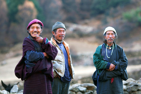 tantric: LHO, MANASLU CONSERVATION AREA, GORKHA, NEPAL - NOVEMBER 28: Tibetan monks poses for a photo on November 28, 2009 in in Lho village, Gorkha District, Nepal Editorial