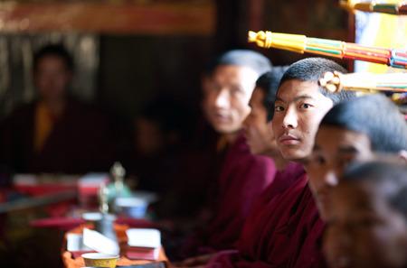 puja: GORKHA, NEPAL - NOVEMBER 28: Portrait of buddhist monk during puja ceremony in a monastery on november 28, 2009 in Gorkha District, Manaslu Area, Nepal