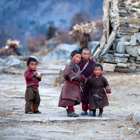 Nepalese kids in national clothes poses for a photo on November 29, 2009 in Gorkha District, Manaslu Area, Nepal Editorial