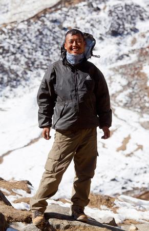 sherpa: Sherpa trekking guide at the mountain pass on November 30, 2009 in Manaslu Conservationa area, Nepal Himalaya Editorial
