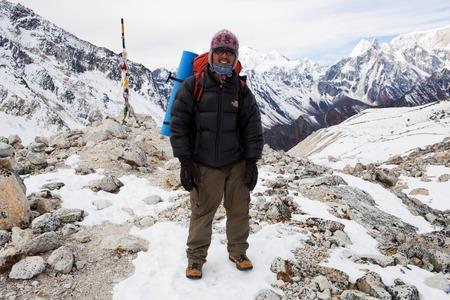 sherpa: GORKHA, NEPAL - DECEMBER 02: Sherpa trekking guide on the Larke Pass on December 02, 2009 in Gorkha District, Manaslu Area, Nepal. Trekking in the Manaslu region.