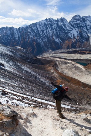 sherpa: GORKHA, NEPAL - DECEMBER 02, 2009: Sherpa trekking guide walking across Larke Pass in Manaslu Nationa Park, Nepal Editorial