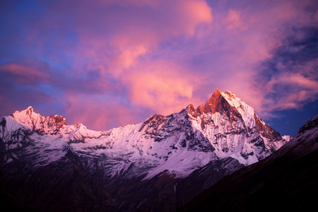 dramatic sunrise: Mount Machapuchare Fishtail at sunset, view from Annapurna base camp. Machhapuchchare is a mountain in the Annapurna Himal of north Central Nepal.