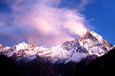 fishtail: Mount Machapuchare Fishtail at sunset, view from Annapurna base camp. Machapuchare or Machhaphuchhare is a mountain in the Annapurna Himal of north Central Nepal.