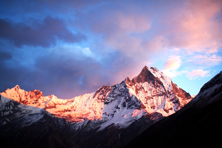 Mount Machapuchare Fishtail at sunset, view from Annapurna base camp. Machapuchare or Machhaphuchhare is a mountain in the Annapurna Himal of north Central Nepal.