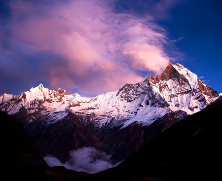 fishtail: Peak Machapuchare Fishtail at sunset, view from Annapurna base camp. Machapuchare or Machhaphuchhare is a mountain in the Annapurna Himal of north Central Nepal.