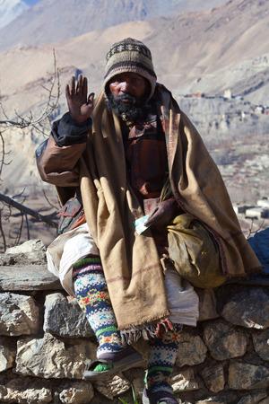 seeks: MUKTINATH, LOWER MUSTANG, NEPAL - DECEMBER 24: Sadhu pilgrim holy man seeks alms in Vishnu temple on December 24, 2009 in Muktinath, Annapurna conservation area, Nepal