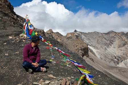 sherpa: Sherpa trekking guide resting on the pass in Upper Dolpo restricted area, North-West regions of Nepal