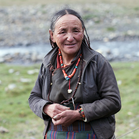 gompa: SHEY GOMPA, NEPAL - SEPTEMBER 4: Tibetan woman poses for a photo on September 4, 2011 in Shey village, Nepal