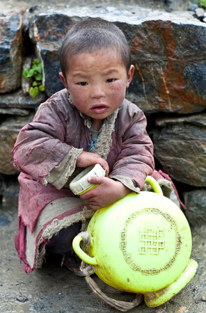 indigence: SHEY GOMPA, NEPAL - SEPTEMBER 04: Portrait of tibetan boy Dorje Lhakpa, 6, from the village of Tibetan refugees on September 04, 2011 in Dolpa District, Nepal Editorial