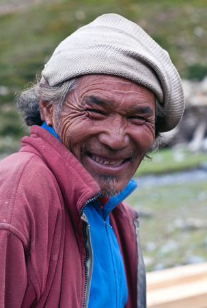 drover: SHEY GOMPA, NEPAL - SEPTEMBER 04: Portrait of tibetan drover from the village of Tibetan refugees on September 04, 2011 in Dolpa District, Nepal Editorial