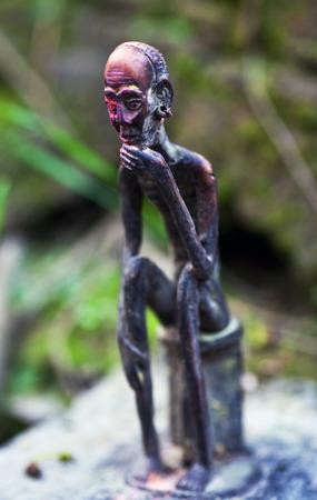 mahadev: Old small statuette of local guardian spirits near holy Gupteshwor Mahadev cave in Pokhara, Nepal