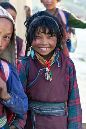 pauper: SALDANG - SEPTEMBER 06: Tibetan student poses for the photo during her break time on September 06, 2011 in Saldang, Upper Dolpo, Nepal
