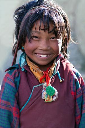 SALDANG, NEPAL - SEPTEMBER 06, 2011: Tibetan girl poses for the photo in Upper Dolpo, Nepal Editorial