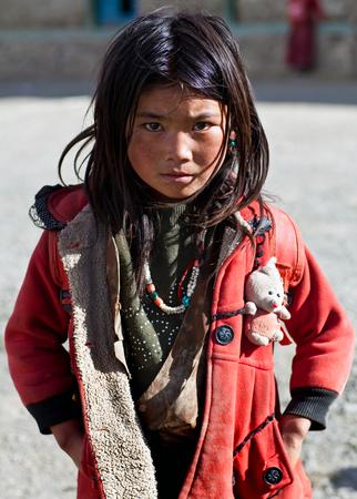 SALDANG, NEPAL - SEPTEMBER 06: Tibetan girl poses for the photo during Full Moon Festival on September 06, 2011 in Saldang, Upper Dolpo, Nepal Redakční