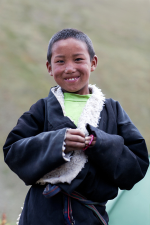 drover: DHO TARAP, NEPAL - SEPTEMBER 10, 2011: Student of Crystal Mountain School poses for a photo during Full Moon festival in Dho Tarap village, Dolpo, Nepal Editorial
