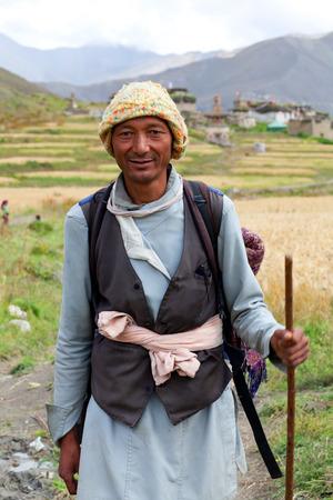 DHO TARAP, NEPAL - SEPTEMBER 10, 2011: Nepalese man walking on the road in Dho Tarap, Upper Dolpo, Nepal Editorial