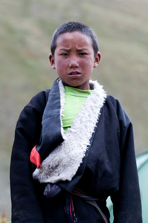 drover: DHO TARAP, NEPAL - SEPTEMBER 10: Young student of Crystal Mountain School poses for a photo during Full Moon festival on September 10, 2011 in Dho Tarap village, Dolpo, Nepal