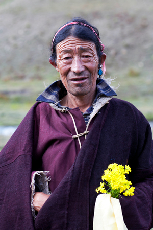 DHO TARAP, NEPAL - SEPTEMBER 11, 2011: Tibetan nomad poses for a photo during Dho Tarap Full Moon festival in Dho Tarap village, Upper Dolpo, Nepal