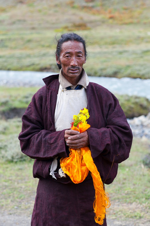 vows: DHO TARAP, DOLPO, NEPAL - SEPTEMBER 11, 2011: Tibetan man in traditional clothes poses for a photo during Dho Tarap Full Moon Festival in Dho Tarap village, Nepal. In Tibetan Buddhism and Bon, a Ngakpa is a person who has received mantrayana vows and devo Editorial