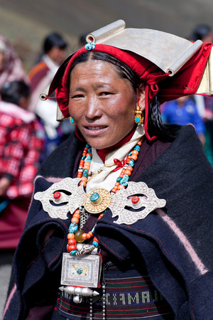 DHO TARAP, DOLPO, NEPAL - SEPTEMBER 11: Tibetan women in national clothes poses for a photo during Dho Tarap Full Moon Festival on September 11, 2011 in Dho Tarap village, Dolpo district, Nepal
