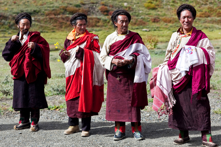 pauper: DHO TARAP, NEPAL - SEPTEMBER 11: An unidentified Tibetan monks posing for the photo during the local Dho Tarap Full Moon Festival on September 11, 2011 in Dho Tarap Village, Dolpo district, Nepal