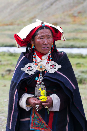 DHO TARAP, DOLPO, NEPAL - SEPTEMBER 11, 2011: Tibetan women in national clothes poses for a photo during Dho Tarap Full Moon Festival in Dho Tarap village, Dolpo district, Nepal