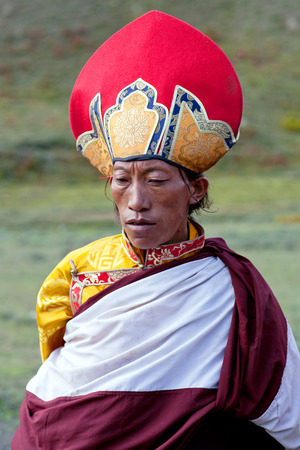 DHO TARAP, NEPAL - SEPTEMBER 11: Tibetan monk in national clothesl poses for a photo during Full Moon festival on September 10, 2011 in Dho Tarap village, Upper Dolpo, Nepal Editorial